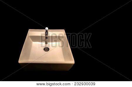 White Wash Basin Isolated In Black Background