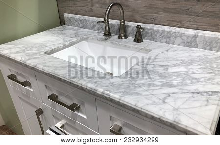 marble stone, marble countertop, bathroom vanity with marble countertop, white cabinets under marble countertops, white sink under marble counter