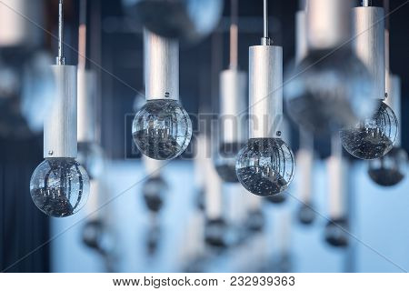 Luxury Interiors Of Chandelier Light Pattern Background At Modern Building.selective Focus With Shal