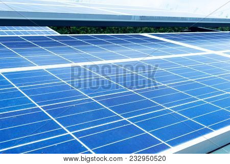 Blurred Solar Energy Panel Photovoltaics Module With Sunlight Reflection