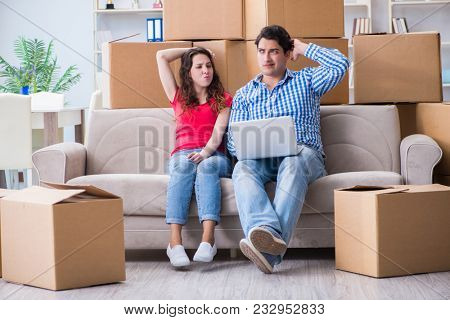 Young pair moving in to new house with boxes