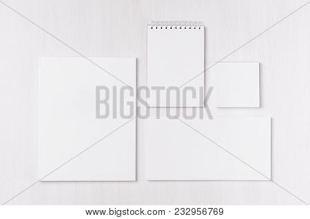 White Blank Envelope, Letterhead, Notepad, Stickers On Soft White Wood Board. Mock Up For Branding,