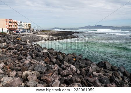 Corralejo, Fuerteventura, Canary Islands, Spain - February 16, 2018: Breakwater Of Harbour Of Corral