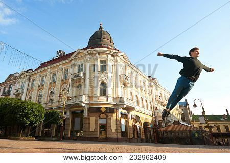 Ivano-frankivsk, Ukraine - 1 June 2015 : Young Dancing Boy Is Making Pirouettes On The Morning City