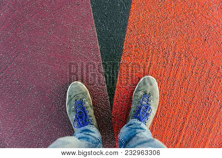 Reaching A Crossroads Having To Decide About Past, Now And Future Symbolized By Two Feet And Shoes S