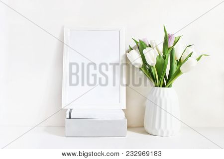 White Blank Wooden Frame Mockup With Spring Bouquet Of Tulips In Porcelain Vase And Pile Of Books Ly