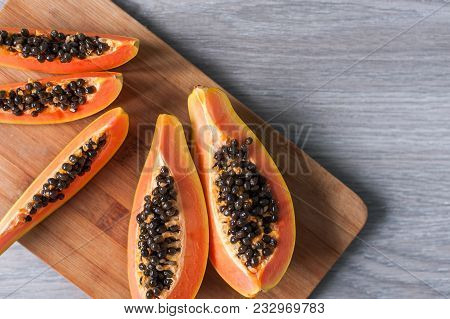Papaya On Wooden Background. Healthy Food, Ripe Exotic Fruits. The Concept Of Vegetarianism