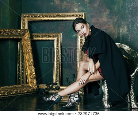 Beauty Rich Brunette Woman In Luxury Interior Near Empty Frames, Wearing Fashion Clothes, Lifestyle