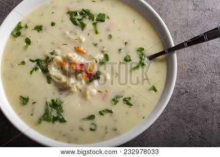 Romanian Traditional Soup - Ciorba De Burta In White Bowl With Spoon