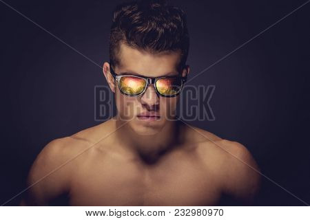 Fashionable Portrait Of Shirtless Muscular Man Model In A Sunglasses.