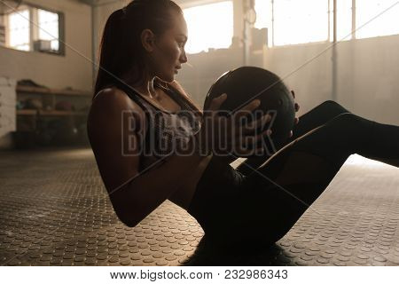 Determined Fitness Woman Exercising With Pilates Ball At  Healthclub. Female Doing Workout Using Med