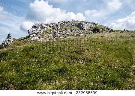 Mountain Meadow With Small Rocks And Blue Sky With Clouds On Skalky Hill In Lucanska Mala Fatra Moun