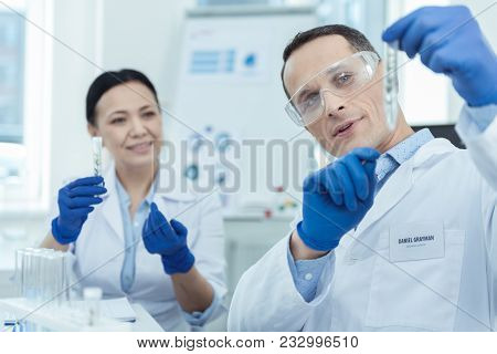 Lab Research. Professional Researchers Holding Test Tubes While Workign In A Lab
