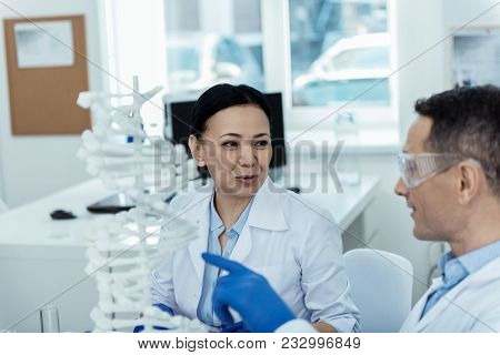 Study Mutation. Pleasant Professional Researchers Studying Dna Model In A Lab