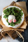 Spring holiday Easter, cake with cream, animals from mastic. Light background. Easterrabbit poster