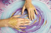 Two open empty Mehndi hands with palms down isolated on painted background. Gold pattern. Art therapy. poster