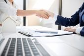 Handshake after good cooperation, Real estate broker residential agent shaking hands with customer after good deal agreement house rent listing contract. poster