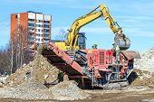 Crawler Mobile Crusher and excavator Crushing concrete poster