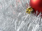 christmas design with red bauble fragment and silver tinsel background poster