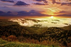 Spectacular Sunrise As Early Morning Fog Settles Into The Valleys Of The Mountains Along The Blue Ri