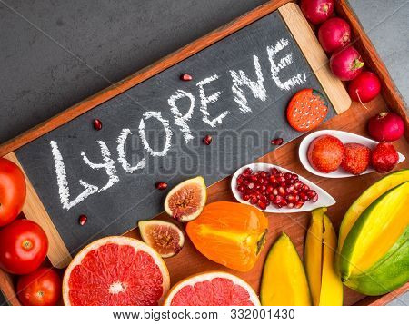 Fruits And Vegetables Containing Lycopene. Healthy Vegan Food Background. Lycopene Is A Red Caroteno