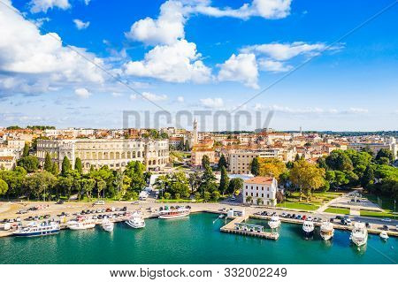 Croatia, Istria, City Of Pula, Ancient Roman Arena, Historic Amphitheater And Harbor With Ships From
