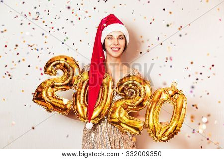 New Year 2020 Gold Number Balloons. Beautiful Woman With Balloons Celebrating New Years Eve Party. I