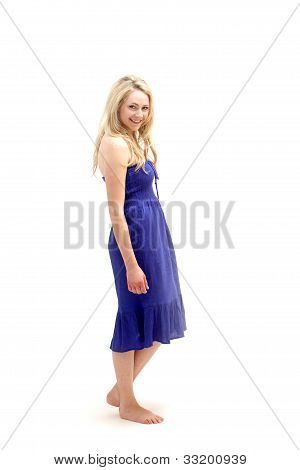 Young Barefoot Lady In Blue Dress