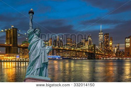 The Statue Of Liberty Over The Scene Of New York Cityscape With Brooklyn Bridge Beside The East Rive