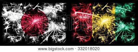 Japan, Japanese Vs Guinea, Guinean New Year Celebration Sparkling Fireworks Flags Concept Background