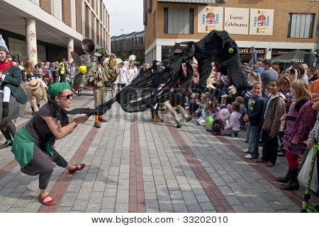 A giant dog costume walks through the streets of Exeter