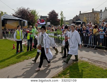 Performers enter Exeter Cathedral Green as part of the Battle for the Winds Parade