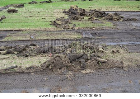 Grass And Soil Or Sod Being Dug Up Under Construction