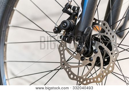 Brake Disc Of A Front Bicycle Wheel. Close Up Photo