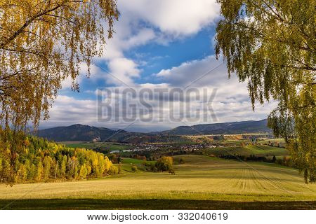Fall In Slovakia. Meadows And Fields Landscape Near Strelniky. Autumn Colored Trees At Sunrise