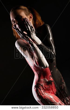 Nude Woman With Red And Black Bodyart View
