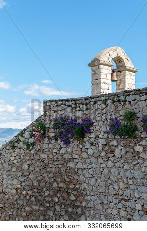 Old venetian caslte or fortress on hilltop in beautiful greek town Nafplio, Peloponnese, Greece poster