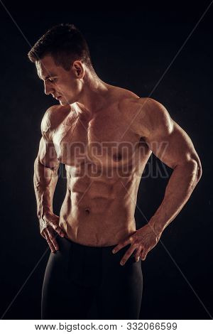 Athletic Shirtless Young Male Fitness Model Posing