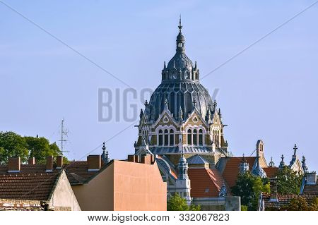 View Of The Dome Of The New Synagogue Against The Blue Sky, Towering Over The Roofs Of The City Of S