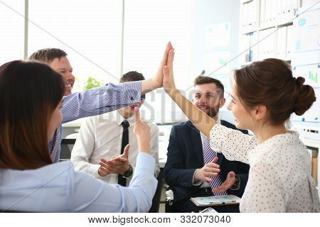 Portrait Of Biz People Performing Friendly Gesture In Order To Celebrate Important Business Event. G