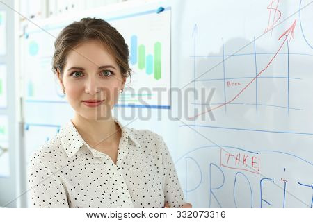 Portrait Of Gorgeous Secretary Standing Near High-tech Glass Desk And Looking At Camera With Great J