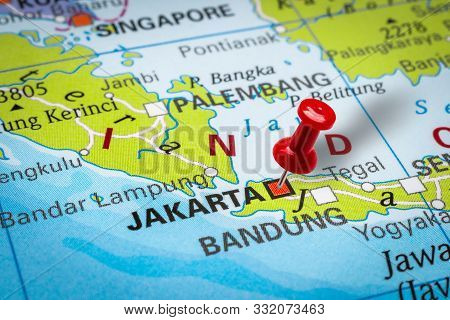 Prague, Czech Republic - October 28, 2019: Red Thumbtack In A Map. Pushpin Pointing At Jakarta City
