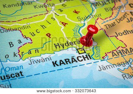 Prague, Czech Republic - October 28, 2019: Red Thumbtack In A Map. Pushpin Pointing At Karachi City