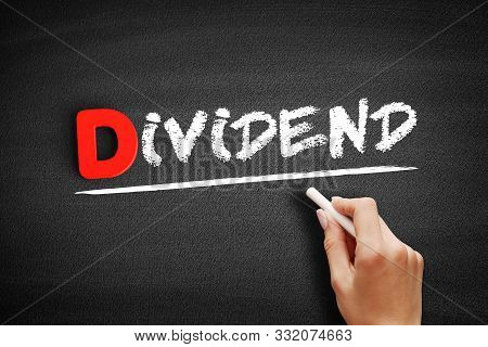 Dividend Text On Blackboard, Business Concept Background