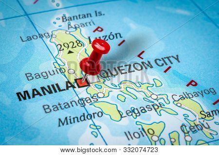 Prague, Czech Republic - October 28, 2019: Red Thumbtack In A Map. Pushpin Pointing At Manila City I