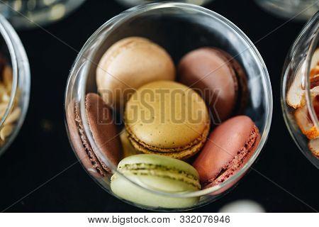Sweet French Macaroon On White Isolated White Background. Fly Falling Sweet Macaroni