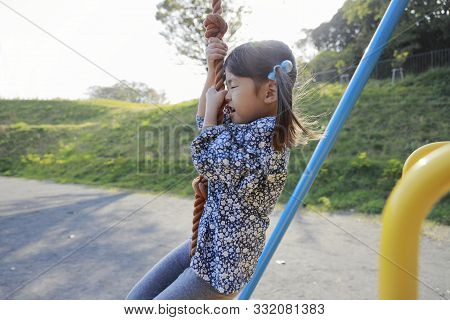 Japanese Girl (5 Years Old) Playing With Flying Fox