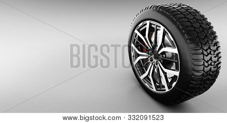 Wheel with modern alu rim on white background - banner. 3D illustration