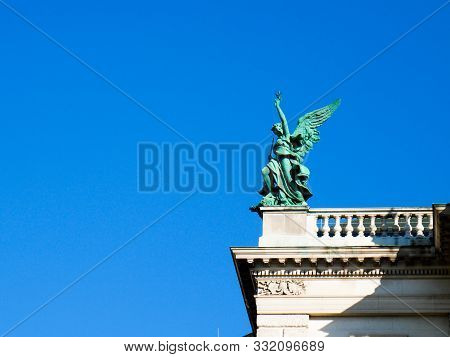 Wien/austria - June 3 2019: Detail Of A Bronze Sculpture Of An Angel On The Top Of A Palace In Vienn