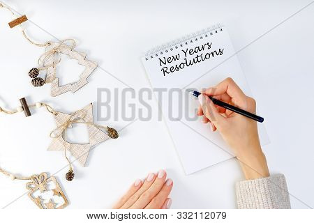 New Years Resolution With A Person Holding A Pen And Notebook. Resolutions, Goals For The New Year.